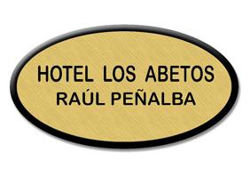 Mod. 2 - Placa de Identificación HOTEL - Placa de Identificación personal para HOTELES forma ovalada, grabación laser. Fabricado en acrílico color DORADO tamaño 7,2x3,9 cm y 1,6 mm de grosor. Fijación con imperdible o fijación magnética.